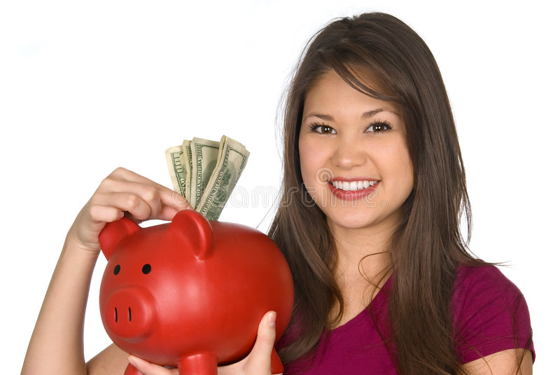 Woman and her piggy bank stock image