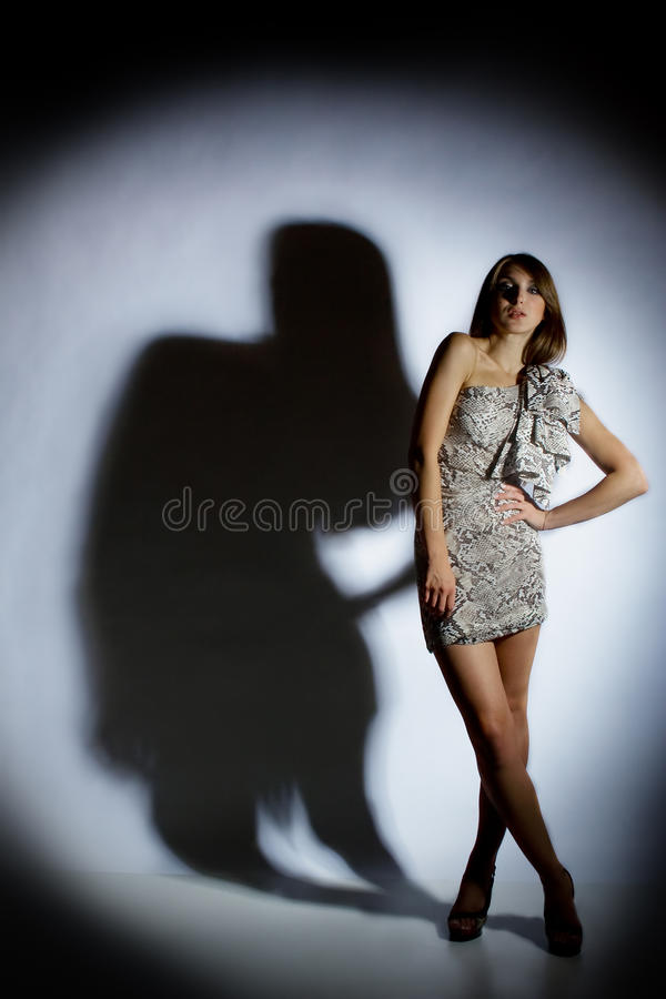 Woman and her shadow stock image