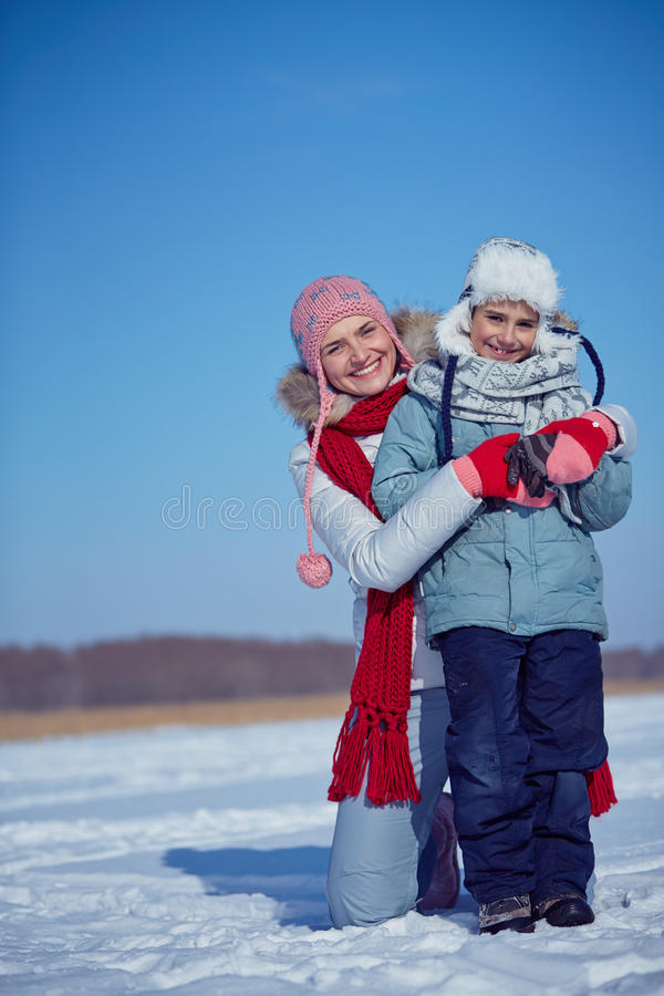 Woman and her son. Happy women and her little son in winterwear royalty free stock photography