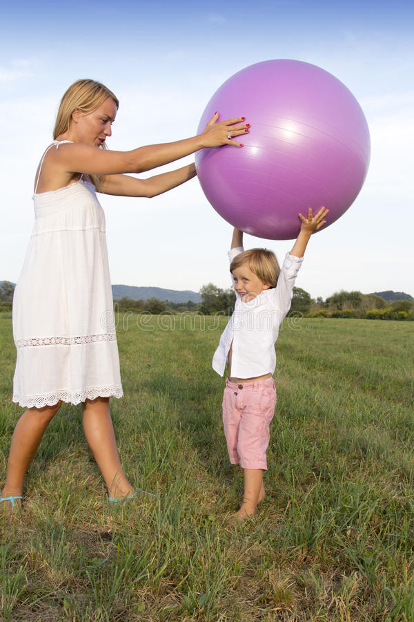Download Woman And Her Son Playing Outdoors Stock Photo - Image: 26359254