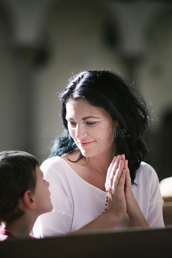 Woman with her son praying royalty free stock photography