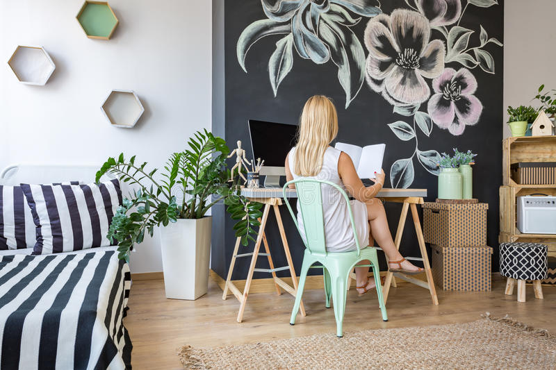 Woman in her study space stock photography