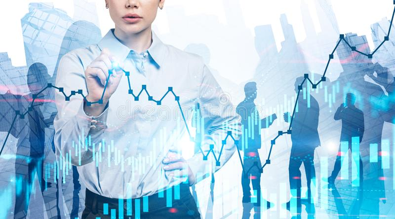Woman and her team working with digital graphs stock photo