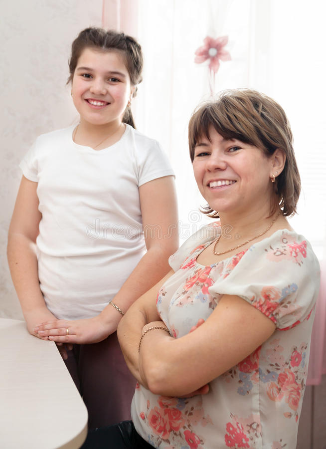 Woman with her teenager daughter royalty free stock photography
