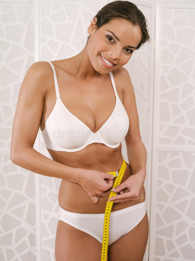 Download Woman In Her Underwear Measuring Her Waist Stock Photo - Image: 35862048