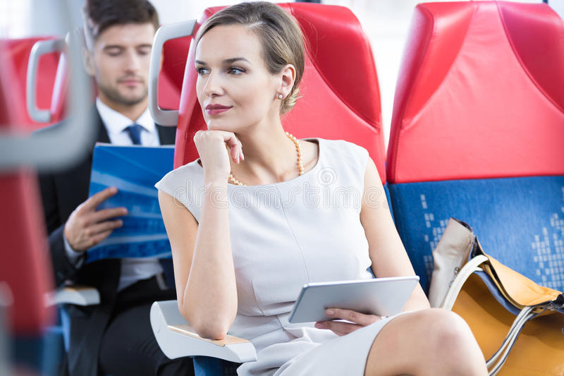 Woman in her way to business meeting. Pretty young elegant women in train going to business meeting stock photos