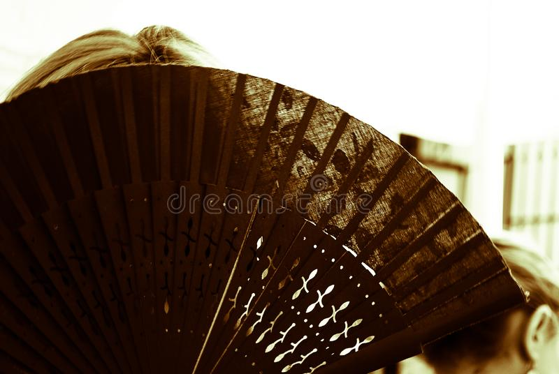 The woman hides behind the fan. Discovering the beautiful Andalusia in southern Spain stock photos
