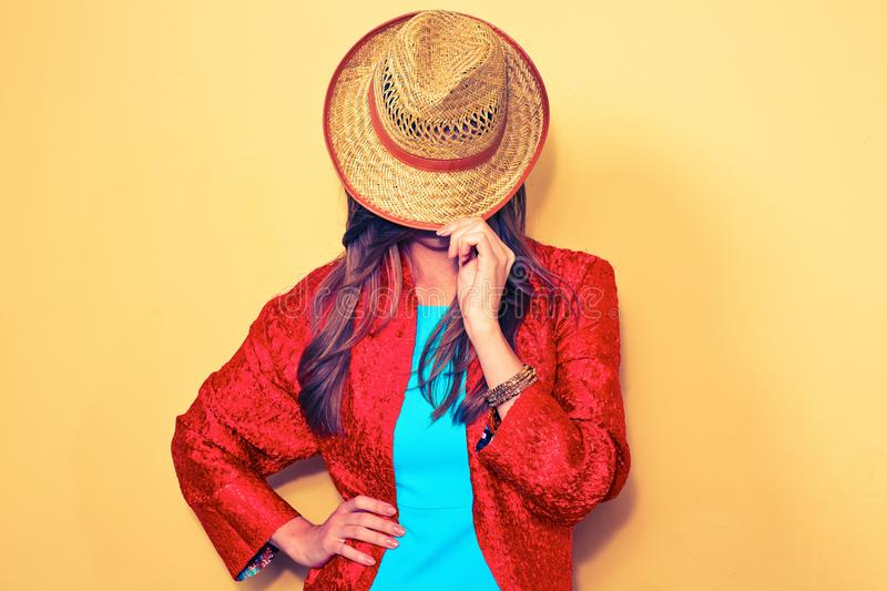 Woman hides face behind a hat. fashion style portrait. stock images