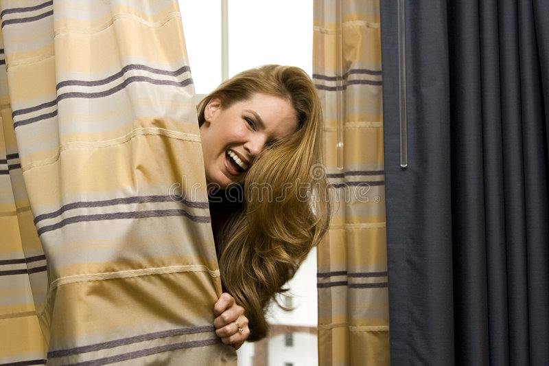 Download Woman Hiding Behind Curtains Royalty Free Stock Photo - Image: 9264665