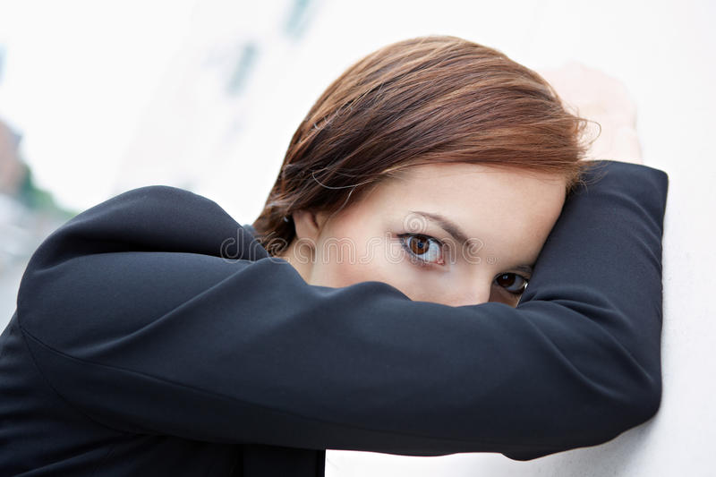 Woman hiding behind her arm royalty free stock image