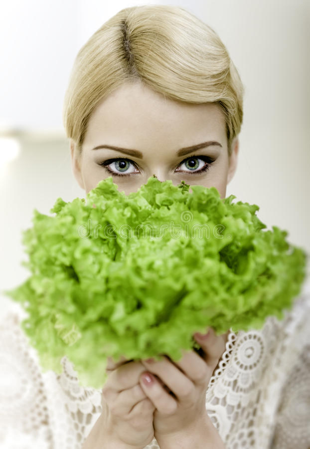 Woman Hiding Behind Lettuce Royalty Free Stock Images