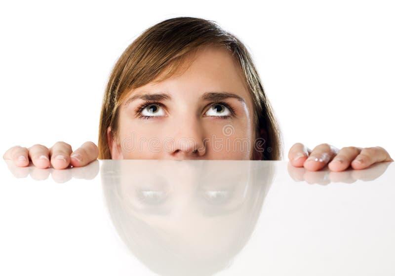 Woman Hiding Behind Table Stock Photos