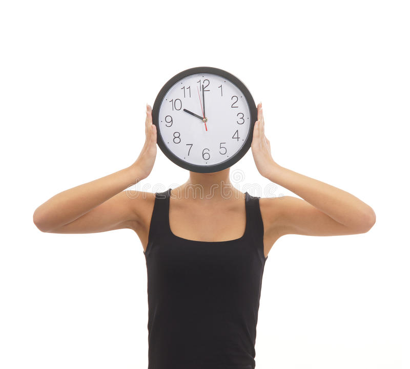 Download A Woman Hiding Her Face Behind A Clock Stock Image - Image: 28091453