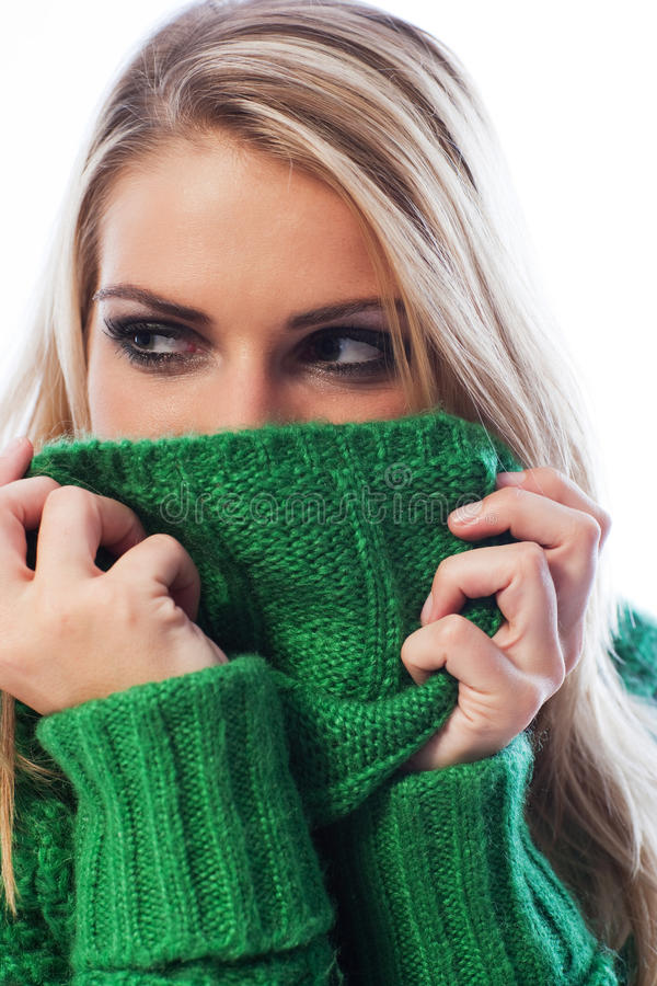 Download Woman Hiding Her Face With Her Sweater Collar Stock Image - Image of snuggling, wool: 31426103