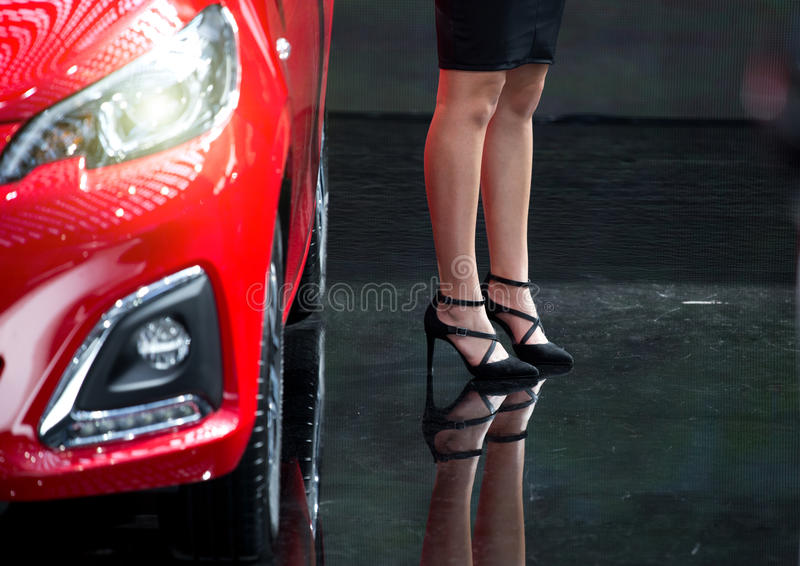 Woman with high heels beside car royalty free stock images