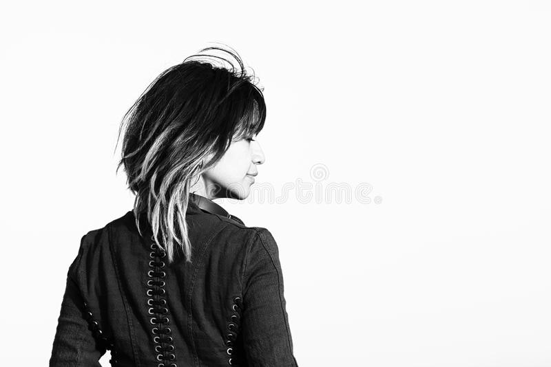 Woman With Highlighted Hair And Jacket From Behind Stock Photo
