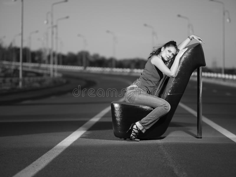 Woman on highway royalty free stock photography