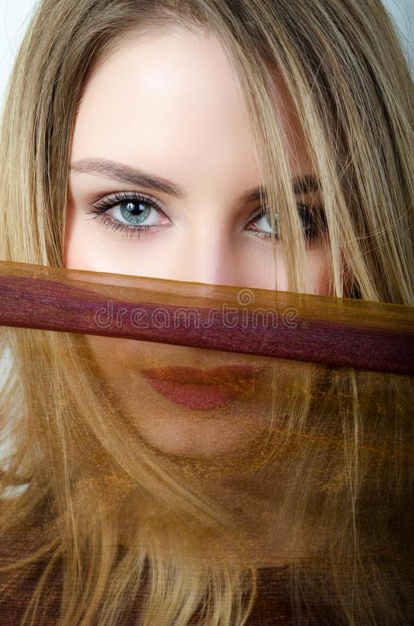 Woman in hijab with blue eyes stock photography