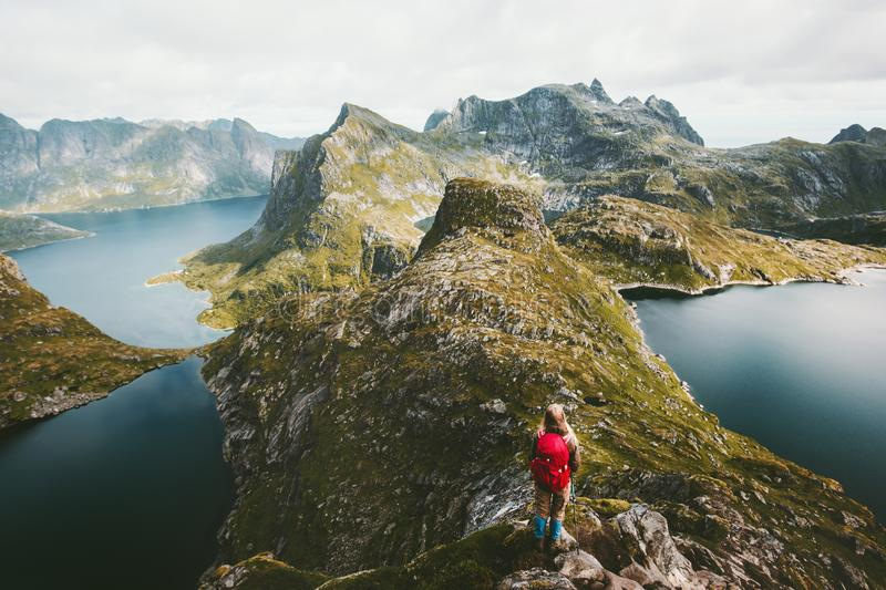 Woman hiker alone with backpack hiking on mountain royalty free stock photography