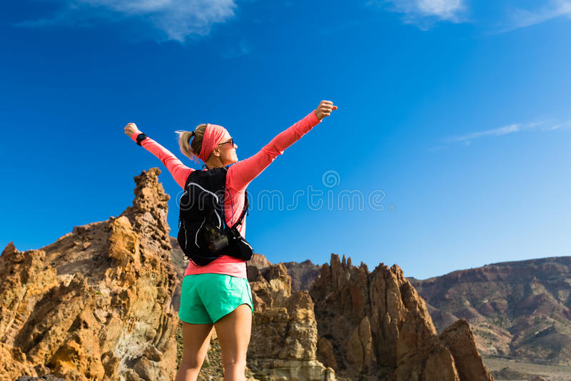 Woman hiker with arms outstretched enjoy mountains royalty free stock photo