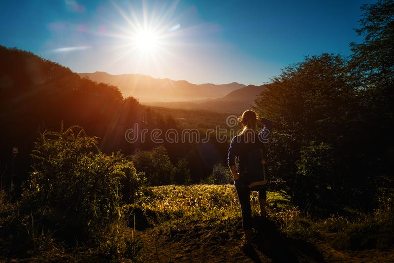 Woman hiker enjoys sunrise. In the mountains. Patagonia, Chile stock images