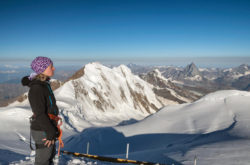 Woman hiker at Gnifetti peak, Monte rosa glcier royalty free stock photos