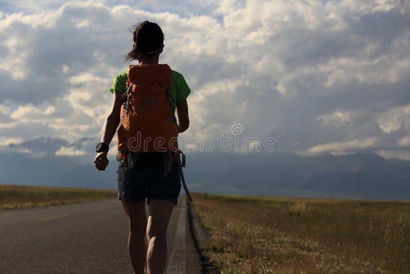 Woman hiker hiking at beautiful mountain trail stock photography