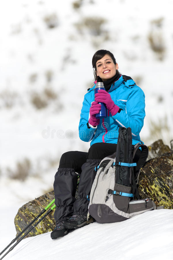 Woman hiker resting drink stock images