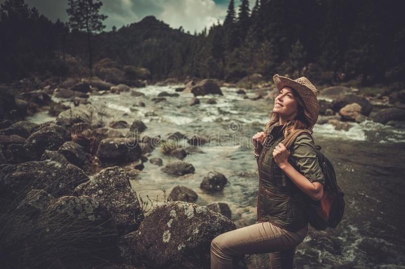 Download Woman Hiker Standing Near Wild Mountain River. Stock Photo - Image: 72550780