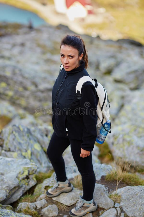 Woman hiker on a trail royalty free stock photos