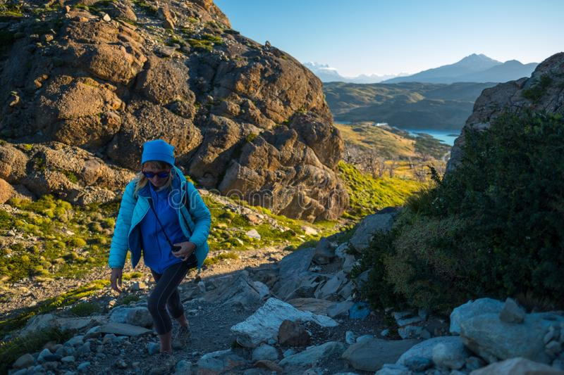 Woman hiker. Walks on the trail in the Torres del Paine National Park. Chile stock photos