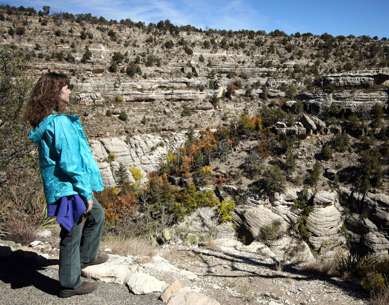 A Woman Hikes in Walnut Canyon royalty free stock photography