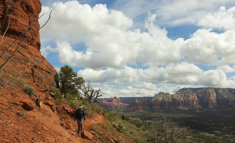 A Woman Hiking the Airport Loop, Sedona, AZ, USA stock images