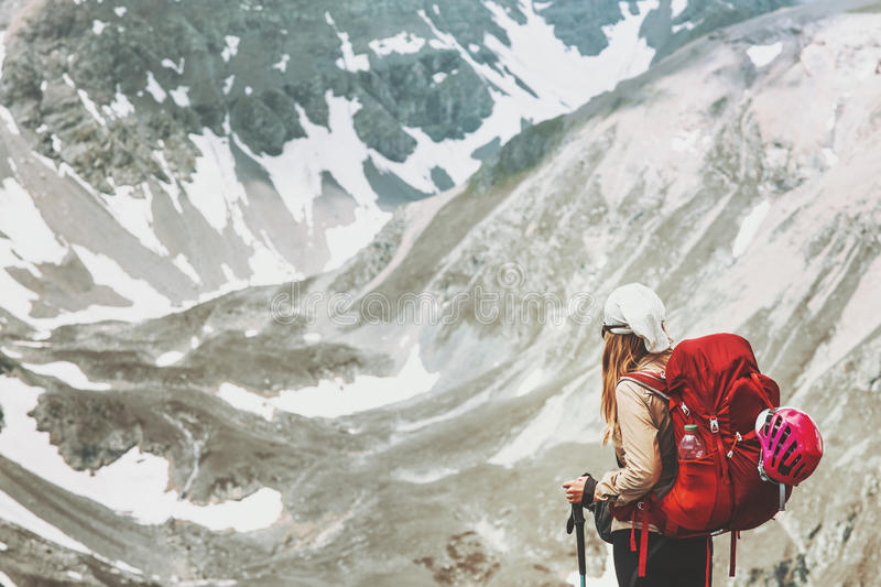 Woman hiking alone at mountains vector illustration