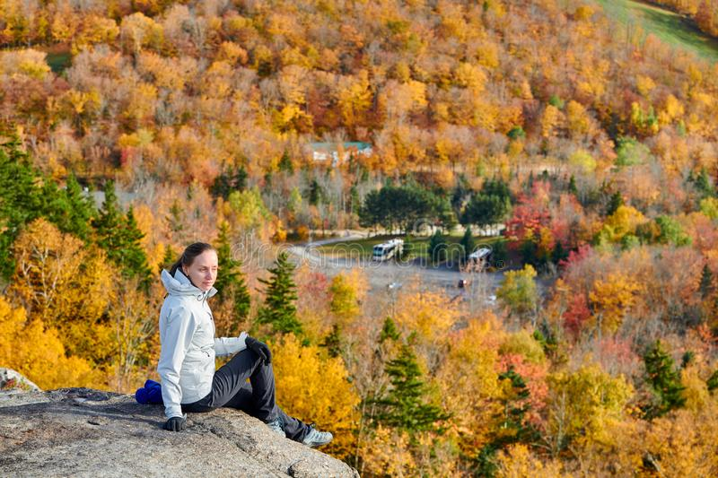 Woman hiking at Artist`s Bluff in autumn stock image