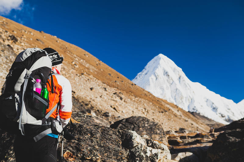 Woman hiking with backpack in Himalaya Mountains. Trekking to Everest Base Camp. royalty free stock photos