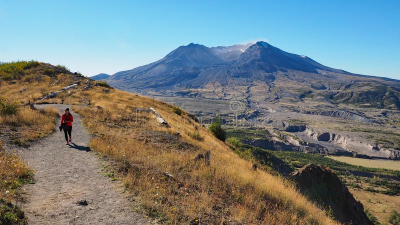 Woman hiking the Boundary Trail at Mount Saint Helens National Volcanic Monument. Woman in red fleece hiking the Boundary Trail at Mount Saint Helens National stock photography