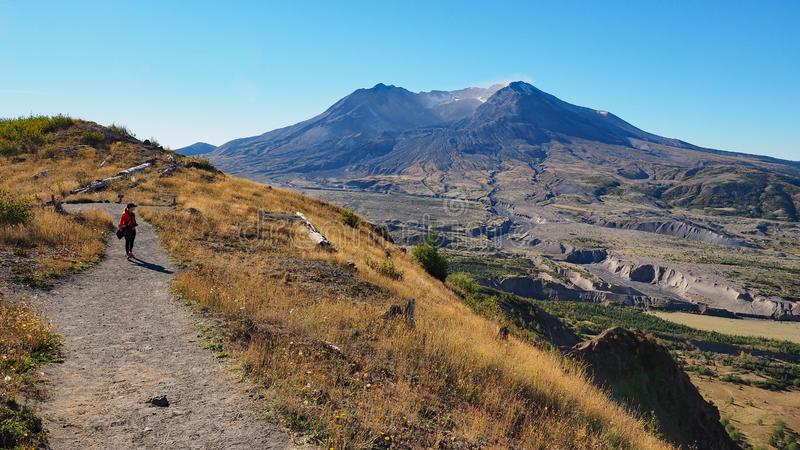 Woman hiking the Boundary Trail at Mount Saint Helens National Volcanic Monument. Woman in red fleece hiking the Boundary Trail at Mount Saint Helens National royalty free stock photo