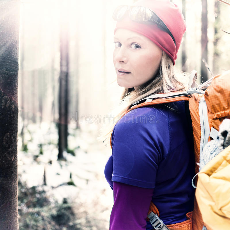 Woman hiking camping in vintage winter forest sunlight stock photos