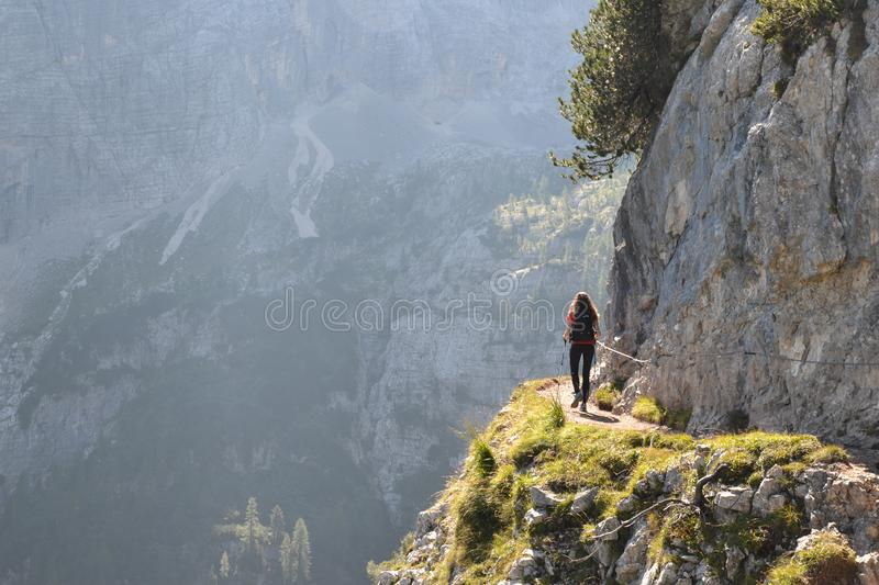 Woman hiking in Dolomites stock images