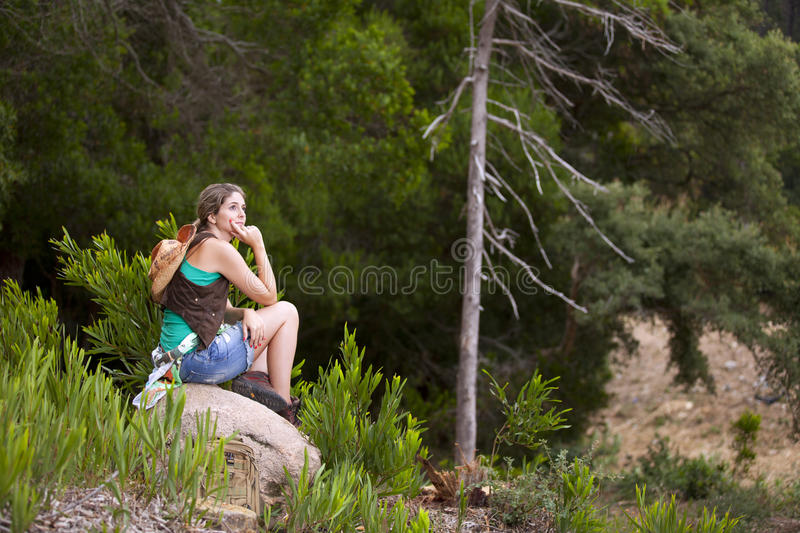 Woman hiking at the forest royalty free stock photo