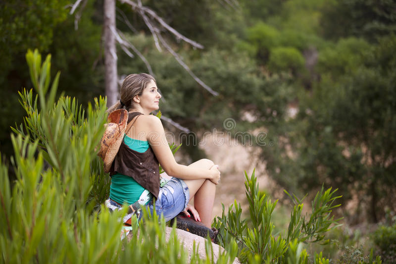 Woman hiking at the forest stock photo