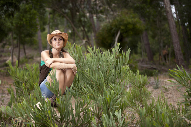 Woman hiking at the forest stock photography