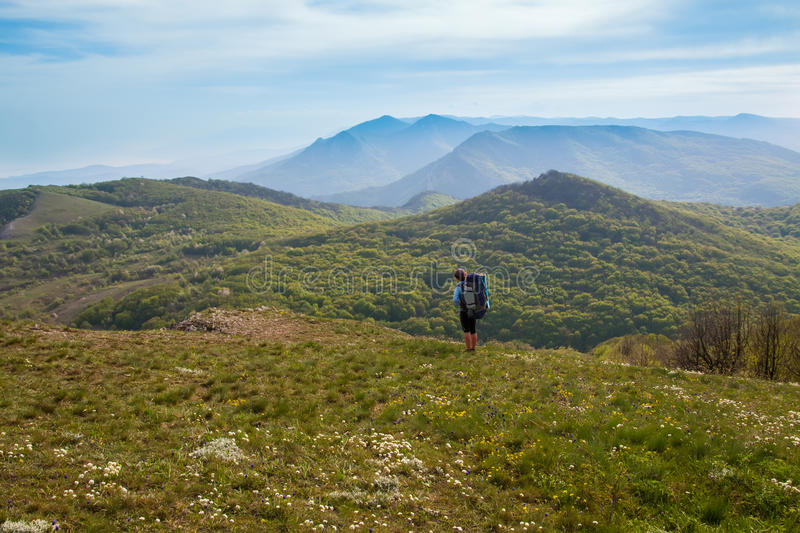 Woman hiking on forest and mountain background stock photos