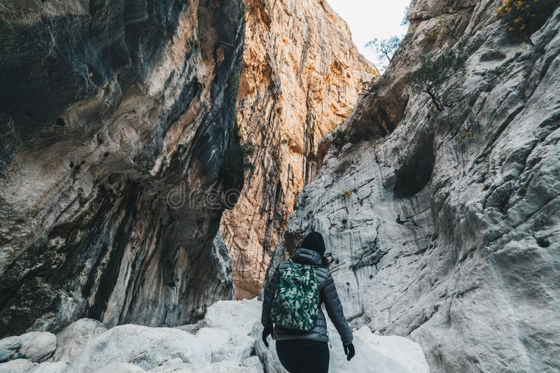 Woman hiking insdide the deepest canyon in Europe - Activity and Health concept - Gola Su Gorroppu.  stock photography