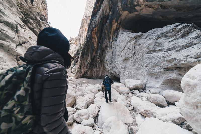 Woman hiking insdide the deepest canyon in Europe - Activity and Health concept - Gola Su Gorroppu. Woman and man hiking in the deepest canyon in Europe royalty free stock photo