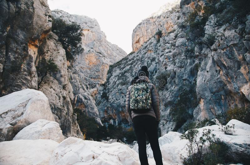 Woman hiking insdide the deepest canyon in Europe - Activity an. D Health concept - Gola Su Gorroppu stock image