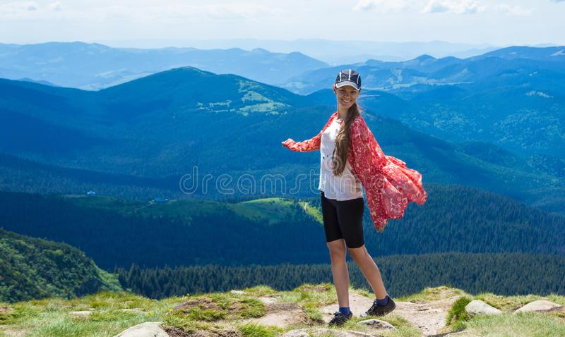 Woman hiking in mountains at sunny day royalty free stock photos