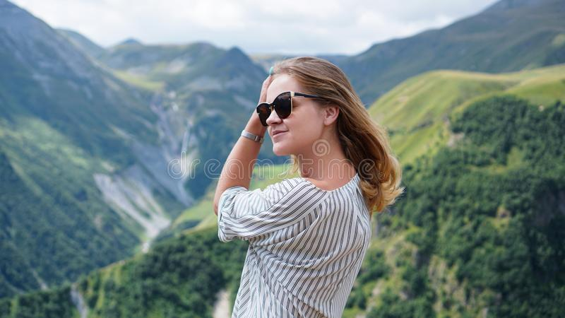Woman hiking in mountains at sunny day time royalty free stock photography