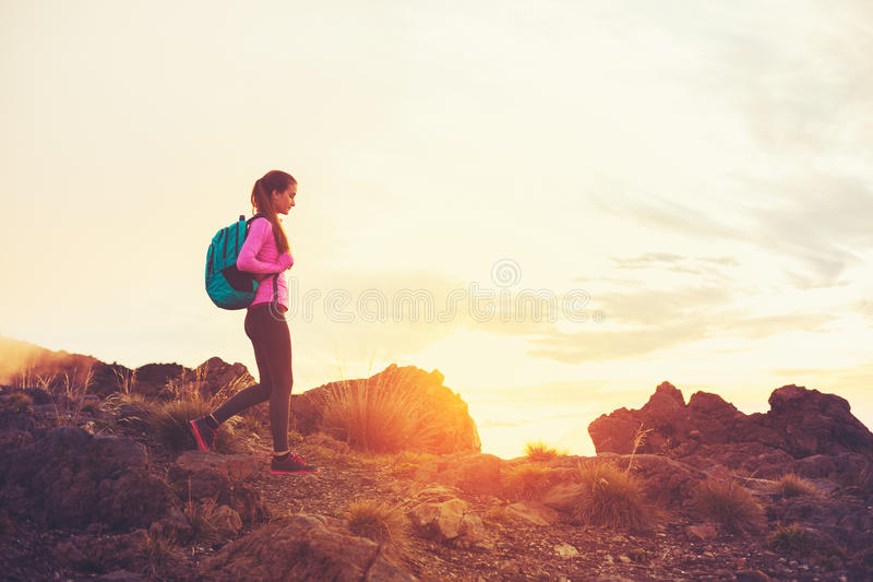 Woman Hiking in the Mountains at Sunset. Adventure Outdoor Active Lifestyle royalty free stock photos